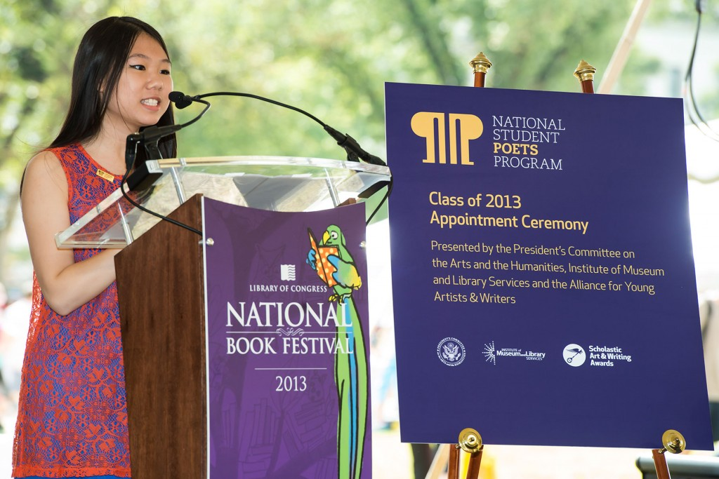 Aline Dolinh reading poems at NSP Appt. Ceremony - cr. Tony Brown